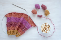 Cup of coffee and knitting on white background Stock Photos