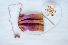Cup of coffee and knitting on white background Stock Image