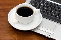 Cup from coffee on the laptop royalty free stock images