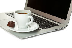 A cup of coffee and laptop Stock Image