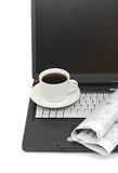 A cup of coffee on a laptop Royalty Free Stock Images