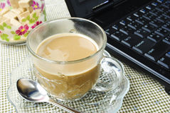 A cup of coffee and a laptop Royalty Free Stock Photo
