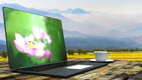 Cup of coffee on a laptop Stock Photography
