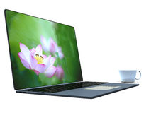 Cup of coffee on a laptop Stock Image