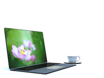 Cup of coffee on a laptop Stock Photo