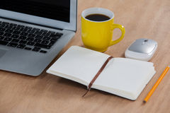 Cup of coffee with laptop, organizer, pencil and mouse Stock Photos