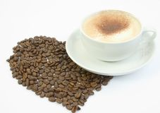 Cup of coffee with large heart. Cup of coffee with coffee beans in the shape of a heart Stock Photo