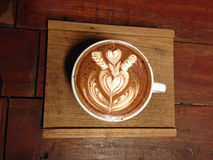 Cup of coffee with latte art Stock Photos