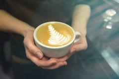 Cup of coffee. Latte art made by barista focus in milk and coffe Royalty Free Stock Photography