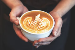 Cup of coffee. Latte art made by barista focus in milk and coffe Royalty Free Stock Photos