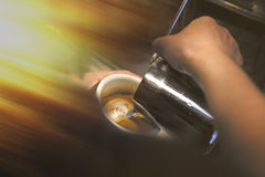 Cup of coffee. Latte art made by barista focus in milk and coffe Royalty Free Stock Photo