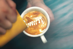 Cup of coffee. Latte art made by barista focus in milk and coffe Stock Images