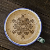 Cup of coffee latte art on wood table. Foam form of star and woo Stock Image