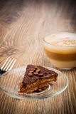 Cup of coffee latte and a cake Stock Photography