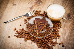 Cup of coffee latte and a cake Stock Photo