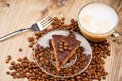 Cup of coffee latte and a cake Royalty Free Stock Photo