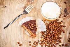 Cup of coffee latte and a cake Stock Photos