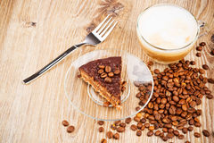 Cup of coffee latte and a cake Stock Image