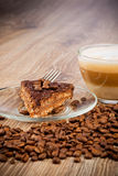 Cup of coffee latte and a cake Stock Images
