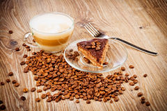Cup of coffee latte and a cake Royalty Free Stock Photography