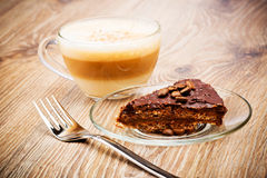 Cup of coffee latte and a cake Royalty Free Stock Photos