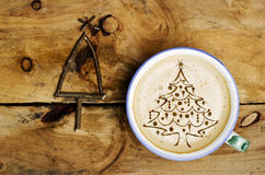 Cup of coffee latte, cappuccino and Christmas tree arranged from Royalty Free Stock Photography