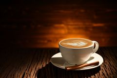 Cup of coffee latte with cinnamon on old wooden Royalty Free Stock Images