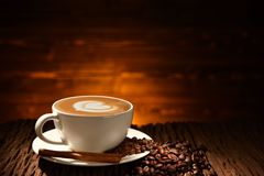Cup of coffee latte and coffee beans Royalty Free Stock Photos