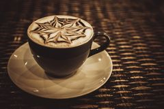 Cup of coffee latte with design art in froth, on a Stock Photos