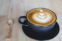 Latte coffee. Cup of coffee latte on wood bar Stock Photos