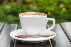 A cup of coffee latte on wood table Royalty Free Stock Image