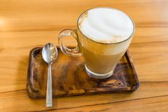 Cup of Coffee Latte on wooden table background Royalty Free Stock Image