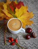 Cup of coffee with leaves and chestnuts Stock Photo