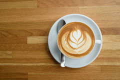 A cup of coffee with leaves pattern Royalty Free Stock Photography