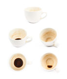 Cup with coffee leftovers isolated Stock Photography
