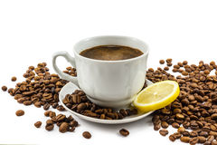 Cup of coffee with lemon and grains Royalty Free Stock Images