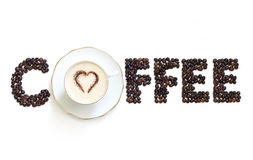 Cup of coffee with letters beans Royalty Free Stock Images