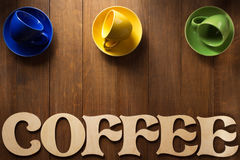 Cup of coffee and letters on wood Stock Photography