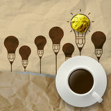 Cup of coffee on light bulb crumpled paper and recycle envelope Stock Photo