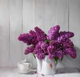 Cup of coffee and Lilac Bouquet Royalty Free Stock Images