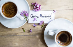 Cup of coffee and lilac flower Stock Image