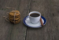 Cup of coffee and linking of oatmeal cookies Stock Photos