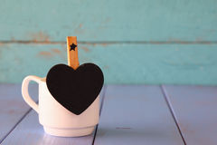 Cup of coffee and little heart shape chalkboard Stock Photography
