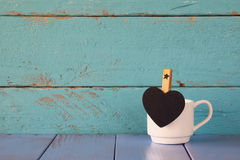 Cup of coffee and little heart shape chalkboard Royalty Free Stock Photos