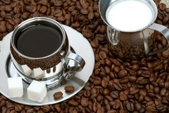 Cup of coffee with lump sugar Royalty Free Stock Image