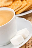 Cup of  coffee with a lump sugar and crackers Royalty Free Stock Photo