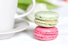 Cup of coffee with macaron on white background Stock Images