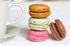 Cup of coffee with macaron on white background Stock Image