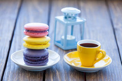 Cup of coffee and macarons with decorate lamp Royalty Free Stock Image