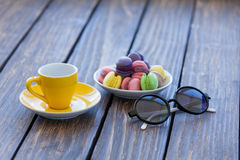 Cup of coffee and macarons with sunglasses Royalty Free Stock Image